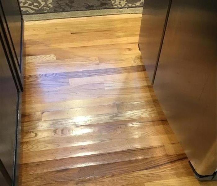 Water Damage to Kitchen Wood Floors Before